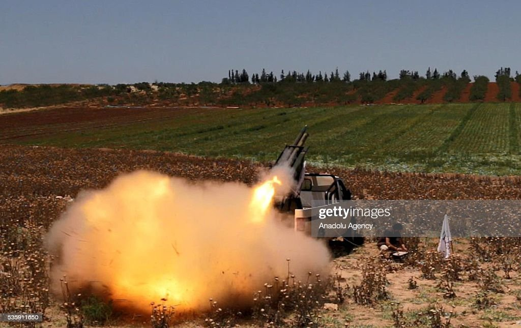 An opposition group's members stage a missile attack in Hama, Syira on May 30, 2016 against Assad Regime forces' Nahl checkpoint, located at the Sqailbiya town.
