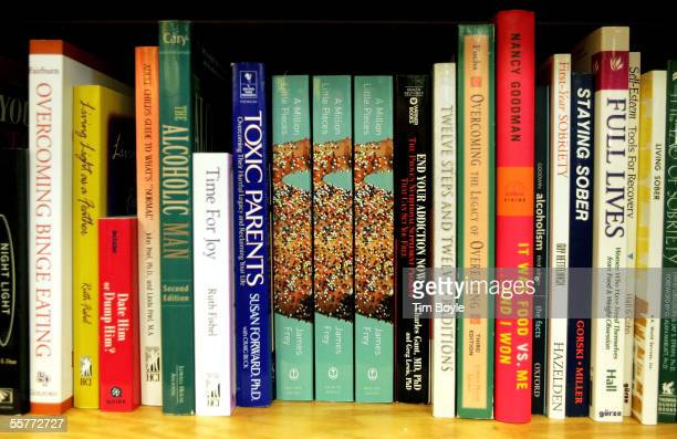 An Oprah's Book Club book titled 'A Million Little Pieces' by James Frey is displayed amongst other selfhelp recovery books at a Borders Book store...