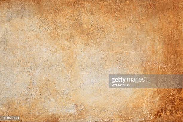 An orange and brown wall texture background