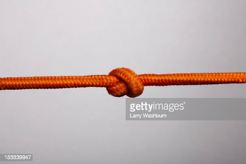 An orange rope with a knot in it