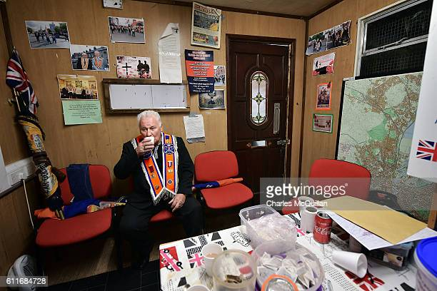 An Orangeman enjoys one of the last cups of tean made at the so called Twaddell protest camp on September 30 2016 in Belfast Northern Ireland The...