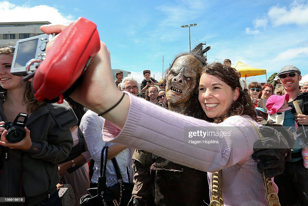 An orc poses for a photo with a fan after a prosthetic demonstration during the Hobbit Artisan Market ahead of the 'The Hobbit: An Unexpected Journey' world premiere at Waitangi Park on November 25, 2012 in Wellington, New Zealand.