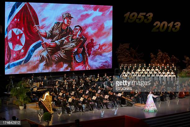 An orchestra plays before a screen during a performance celebrating the 60th anniversary of 'victory in the great Fatherland Liberation War' at the...