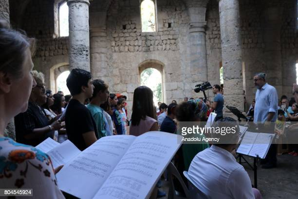 An orchestra which composed of 10 people from different sects and religions performs peace songs during the Feast of Saints Peter and Paul which...