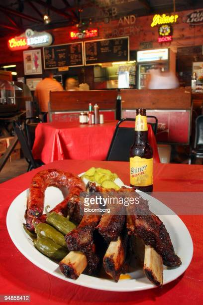 An order of beef ribs and sausage with a Shiner Bock beer is arranged for a photo at Iron Works BBQ in Austin Texas US on Saturday April 26 2008...