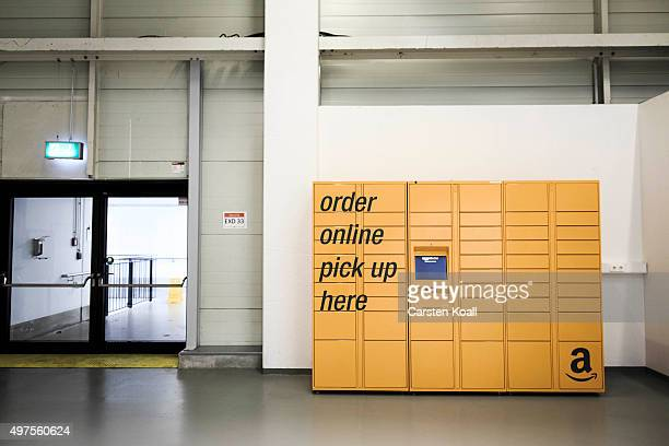 An order online pick up box stays on a floor at an Amazon warehouse on November 17 2015 in Brieselang Germany Germany is online retailer Amazon's...