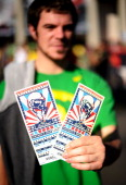 An Oregon Ducks fan holds up his tickets before the 98th Rose Bowl Game against the Wisconsin Badgers on January 2 2012 in Pasadena California