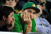 An Oregon Ducks fan sits in the stands as the time winds down in the third quarter of the game between the Oregon Ducks and the Utah Utes at Autzen...