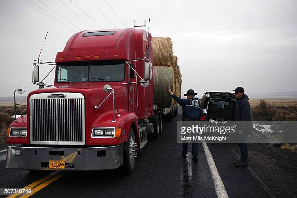 An Oregon State Trooper allows a semitruck carrying hay bales through a road block along the Malheur National Wildlife Refuge January 28 2016 near...