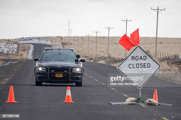 An Oregon State Trooper approaches a road block along the Malheur National Wildlife Refuge January 30 2016 in Burns Oregon Eight protestors who had...