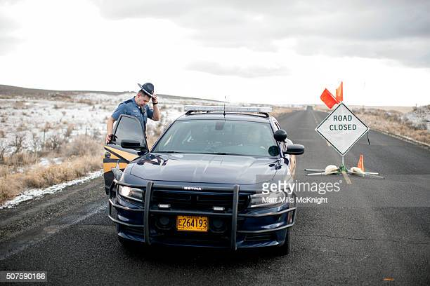 An Oregon State Trooper enters his vehicle at a road block along the Malheur National Wildlife Refuge January 30 2016 in Burns Oregon Eight...