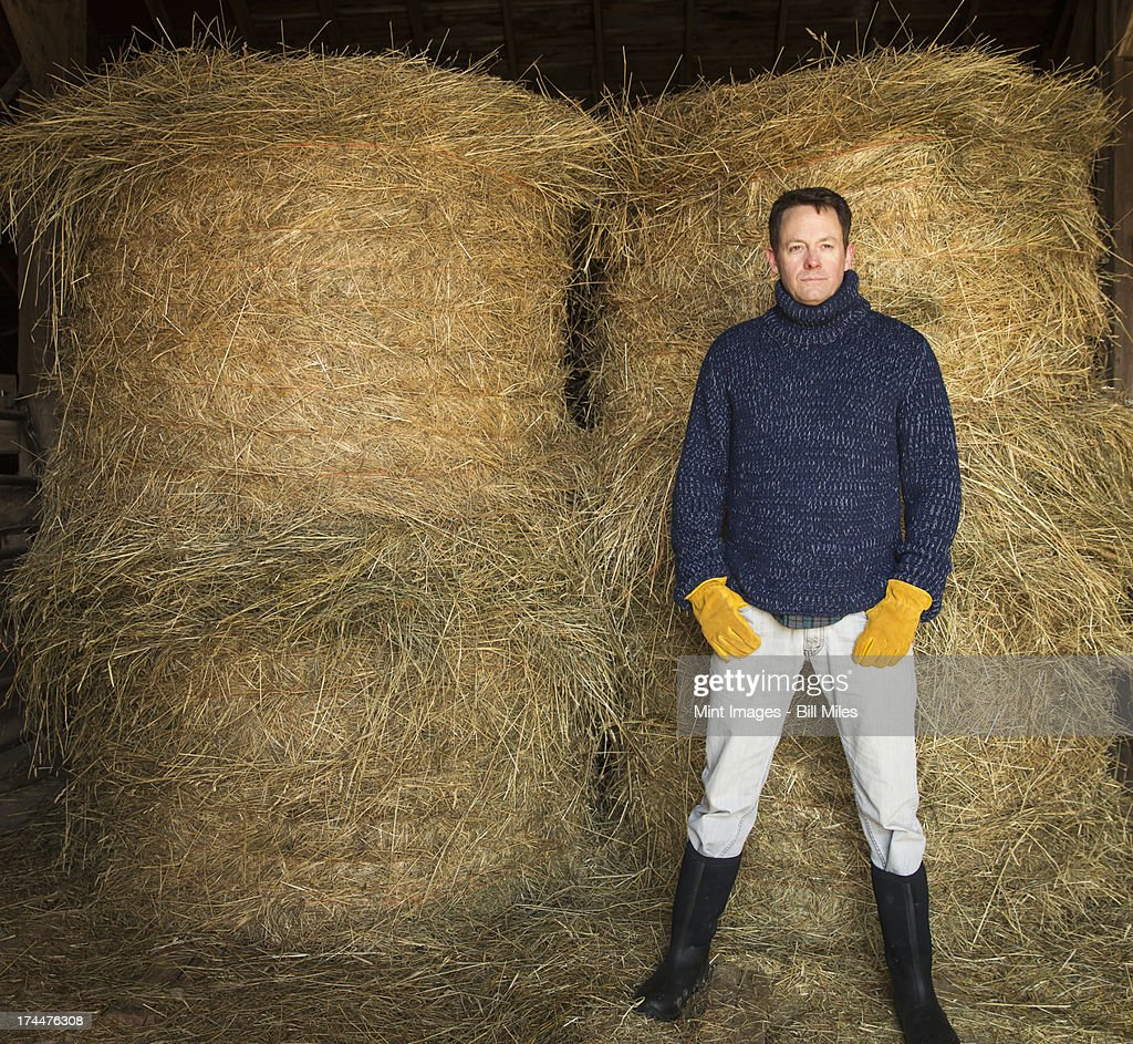 An Organic Farm in Winter in Cold Spring, New York State. A man working outdoors on the farm. : Stock Photo