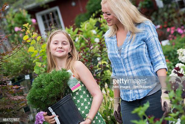 An organic flower plant nursery. A woman and a girl walking.