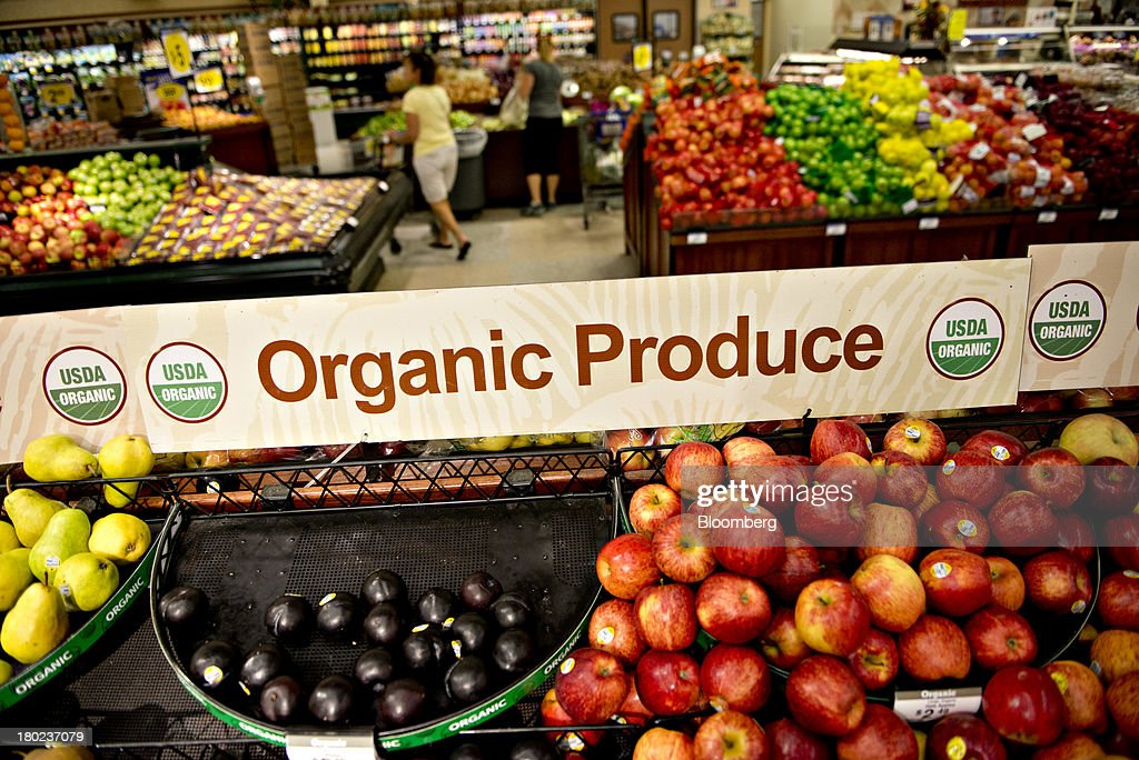 An organic produce sign stands over a display in the produce department of a Kroger supermarket in Peoria Illinois US on Tuesday Sept 10 2013 Kroger...