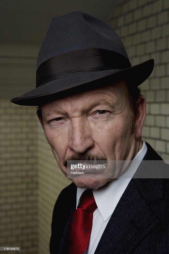 An organized crime boss, portrait