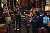 UNDATEABLE 'An Origin Story Walks Into a Bar' Episode 307A Pictured Brent Morin as Justin Christa Miller as Jackie Bridgit Mendler as Candace Rick...