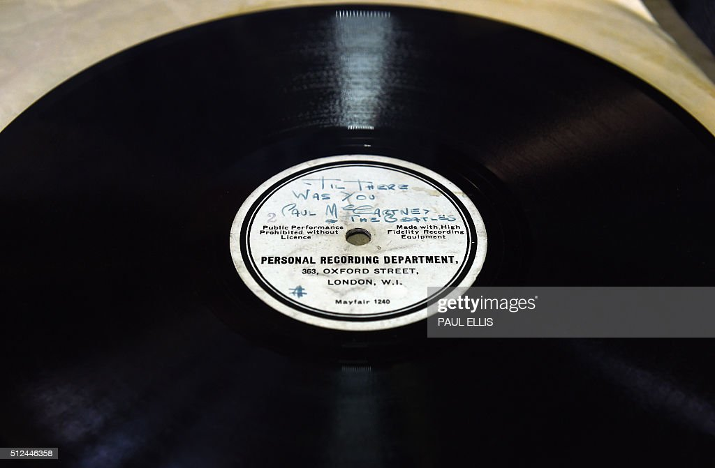 An original 10inch 78RPM acetate recording of 'Till There Was You' and 'Hello Little Girl' by The Beatles at his auction house in Warrington north...