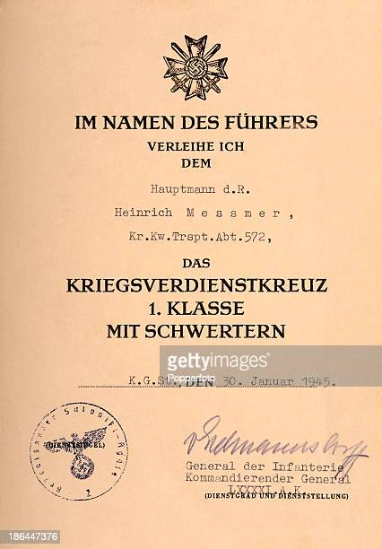 An original certificate awarding Captain Heinrich Messmer the War Merit Cross 1st Class with Swords signed by the General of the Infantry of the...