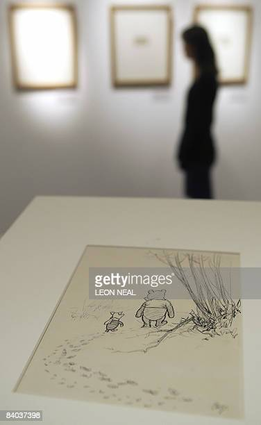 An original illustration of WinniethePooh entitled 'He went on tracking and Pigletran after him' by EH Sheppard is displayed as a gallery assistant...