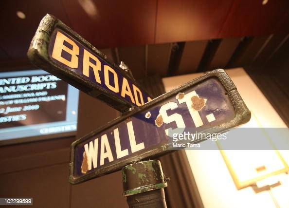 An original late 19th to early 20thcentury Manhattan street sign from Wall Street and Broad Street is seen before being auctioned at Christie's June...