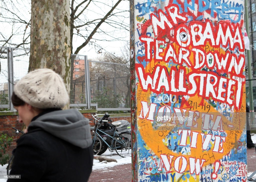An original piece of the Berlin Wall with graffiti of the words 'Mr. Obama Tear Down Wall Street,' a reference to former U.S. President Ronald Reagan's June 12, 1987 demand that General Secretary of the Communist Party of the Soviet Union Mikhail Gorbachev tear down the Berlin wall, stands outside a meeting of the Berlin chapter of the German Pirate Party on February 23, 2013 in Berlin, Germany. After successes in 2011 in regional elections in the German capital and in the following year in the states of Schleswig-Holstein and North Rhine-Westphalia, the German Pirate Party (Piratenpartei), which initially focused on filesharing, censorship and data protection, has seen two of its state-level leaders in the states of Brandenburg and Baden-Wuerttemburg step down in the past few days alone. The party's Berlin representation is meeting over the weekend to choose its candidates for the country's federal elections, to be held on September 22, 2013, which will determine the 598 or more members of the 18th Bundestag, Germany's federal parliament. After well-publicized infighting in the party, many observers are skeptical that the party can reach the 5 percent vote required to join the country's politics on that level.