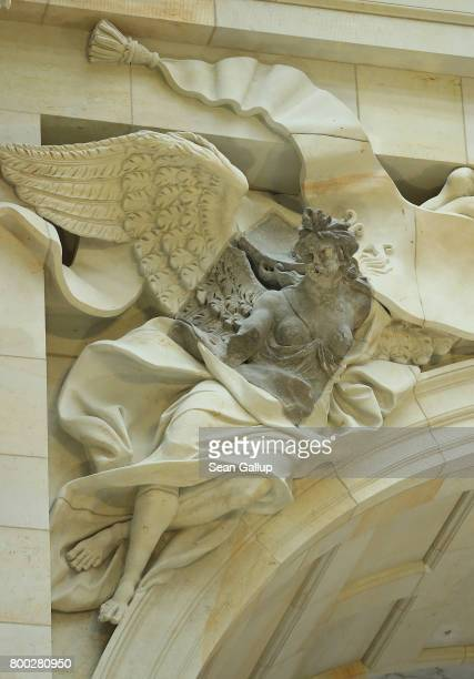 An original portion of a female winged figure combined with the reproduction of the rest decorates the Eosander Portal during open house day at the...