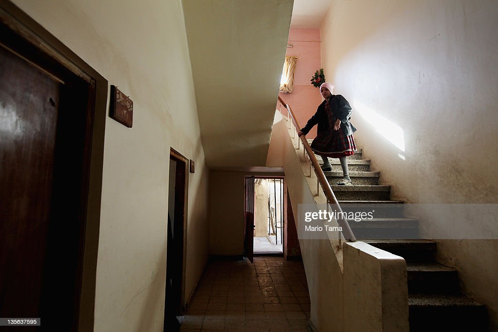 An orphan walks down a stairwell in the orphanage where she lives on December 12, 2011 in Baghdad, Iraq. Estimates suggest there may be more than one million orphans currently in the country, with many having lost parents to war-related violence. Iraq is transitioning nearly nine years after the 2003 U.S. invasion and subsequent occupation. American forces are now in the midst of the final stage of withdrawal from the war-torn country. At least 4,485 U.S. military personnel have died in service in Iraq. According to the Iraq Body Count, more than 100,000 Iraqi civilians have died from war-related violence.