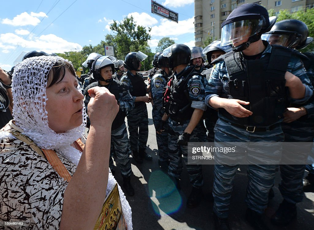 An Orthodox believer clashes with police as she and others protest against a Gay Parade in Kiev on May 25, 2013. Around a hundred gay rights activists marched in Ukraine on Saturday despite fears of violence and a court ban, the post-Soviet country's first ever gay pride event.