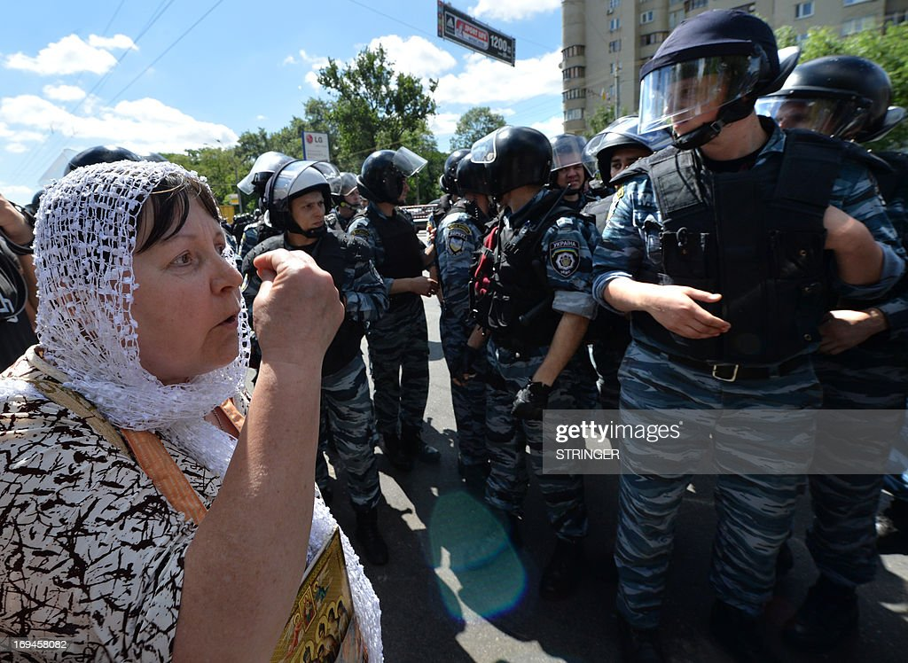 An Orthodox believer clashes with police as they protest against a Gay Parade in Kiev on May 25, 2013. Around a hundred gay rights activists marched in Ukraine on Saturday despite fears of violence and a court ban, the post-Soviet country's first ever gay pride event.