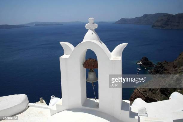 An Orthodox bell tower overlooks the port town of Fyra on the Greek island of Santorini 06 July 2007 With a view to one of the most stunning sunsets...