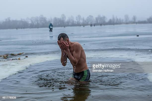 An Orthodox Christian man bathes in the Dnieper River for Epiphany on January 19 2015 in Kiev Ukraine The holiday celebrates the baptism of Jesus for...