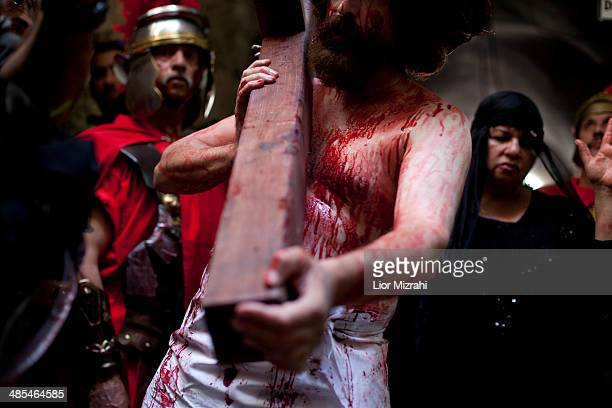 An Orthodox Christian pilgrim from 'The Hope of Glory' order as he reenacts the Passion of Christ along the Via Dolorosa on April 18 2014 in...