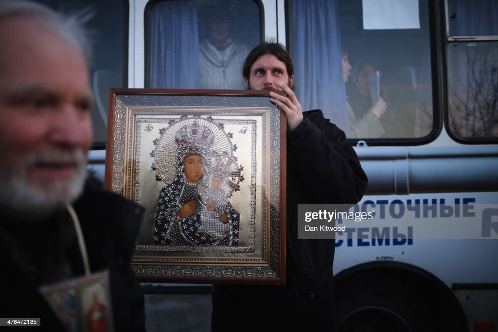 An Orthodox clergy member carries a religious icon at a military checkpoint near a Ukrainian Air-force base on March 13, 2014 in Belbek, Ukraine. As the standoff between the Russian military and Ukrainian forces continues in Ukraine's Crimean peninsula, world leaders are pushing for a diplomatic solution to the escalating situation. Crimean citizens will vote in a referendum on 16 March on whether to become part of the Russian federation.