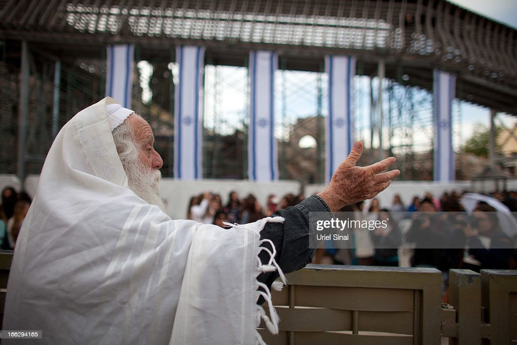 An Orthodox Jewish man chants slogans against member of the religious group 'Women of the Wall,' during a prayer marking the first day of the Jewish month of Iyar at the Western Wall on April 11, 2013 in Jerusalem's Old City, Israel. Five members of the organisation 'Women of the Wall' were detained by police during the group's monthly prayer at the Western Wall, after covering themselves with prayer shawls in contradiction to the holy site's custom.