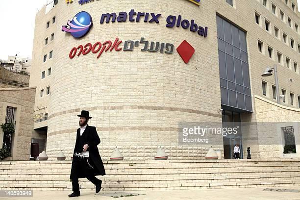 An orthodox jewish man walks away from the offices of Matrix Global a unit of Matrix IT Ltd in Modi'in Illit Israel on Sunday April 29 2012 Israel's...