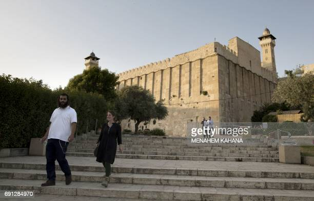 An Orthodox Jewish man walks outside the Patriarchs' Tomb known in Arabic as the Ibrahimi Mosque in the the divided West Bank city of Hebron on May...