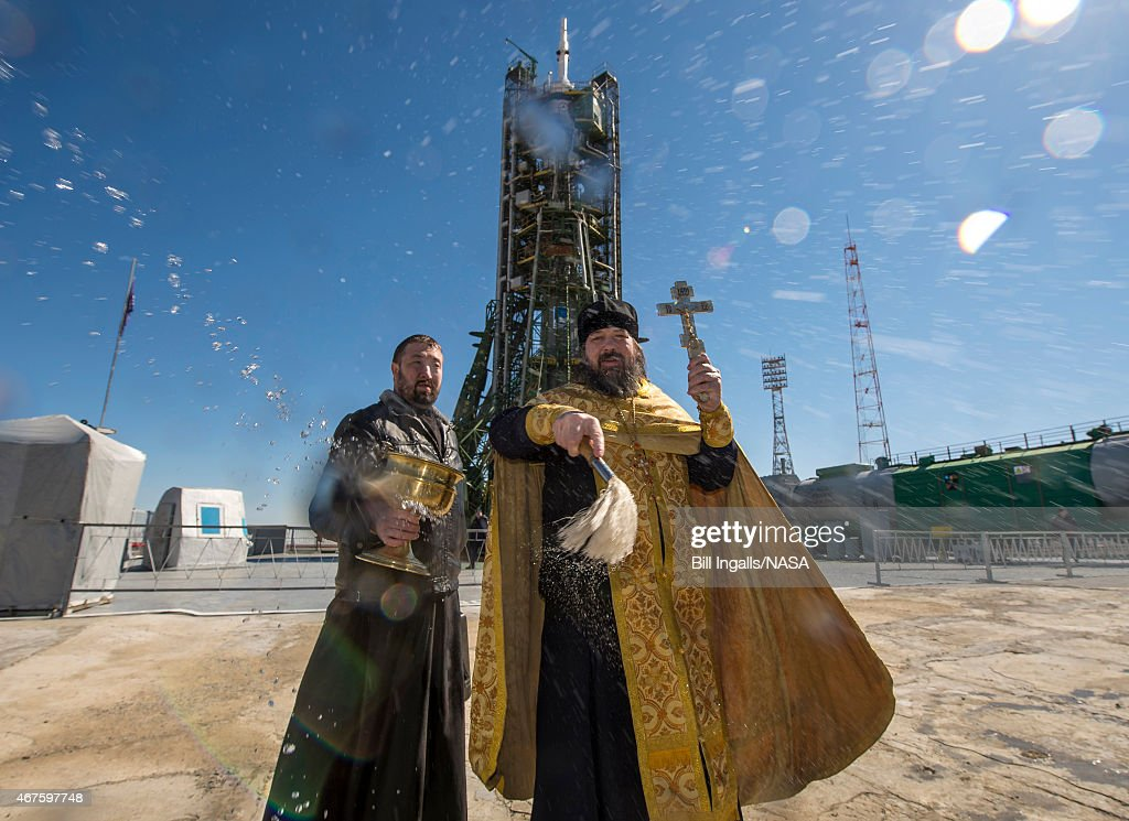 An Orthodox Priest blesses members of the media after he blessed the Soyuz rocket at the Baikonur Cosmodrome Launch pad March 26, 2015 at the Baikonur Cosmodrome in Kazakhstan. NASA Astronaut Scott Kelly, and Russian Cosmonauts Mikhail Kornienko, and Gennady Padalka of the Russian Federal Space Agency are scheduled to launch to the International Space Station in the Soyuz TMA-16M spacecraft from the Baikonur Cosmodrome on March 28 (March 27 EST) returning to Earth on Soyuz TMA-18M in March 2016.