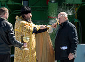 An Orthodox Priest blesses Sergey Semchenko of the Russian Search and Recovery Forces after having blessed the Soyuz rocket at the Baikonur...