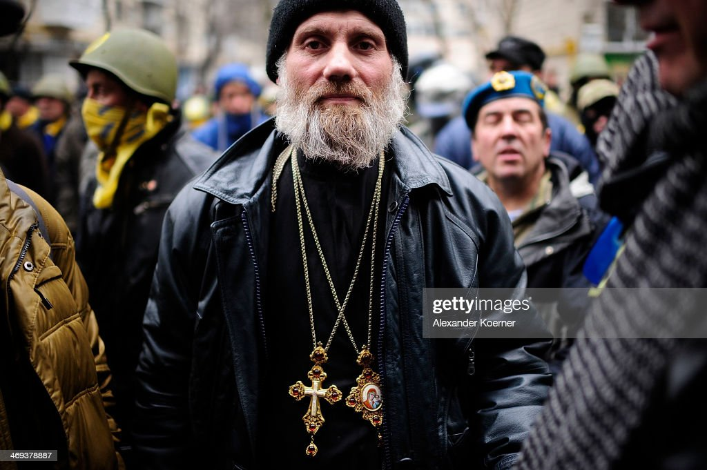 An orthodox priest is pictured during a rally on Instytutska Street on February 14, 2014, in Kiev, Ukraine. According to Opposition Officals, Berkut police forces could attack the barricades any moment; protesters have gathered inside and prepared fireworks and molotov-cocktails. Media and other people were removed from the barricades. Russian Foreign Minister Sergei Lavrov again issued a warning to the West against interfering in Ukraine's political crisis during today's joint press conference with German federal foreign Minister Walter Steinmeier, who is on a two-day visit to Russia. According to reports Ukrainian opposition leaders Vitaly Klitschko and Arseny Yatsenyuk are set to meet with German Chancellor Angela Merkel on February 18, 2014 in Germany.