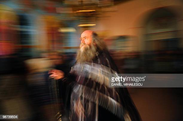 An Orthodox priest member of Lipovene community from Sarichioi village holds the Christian Orhodox religious service on the Good Friday night in...