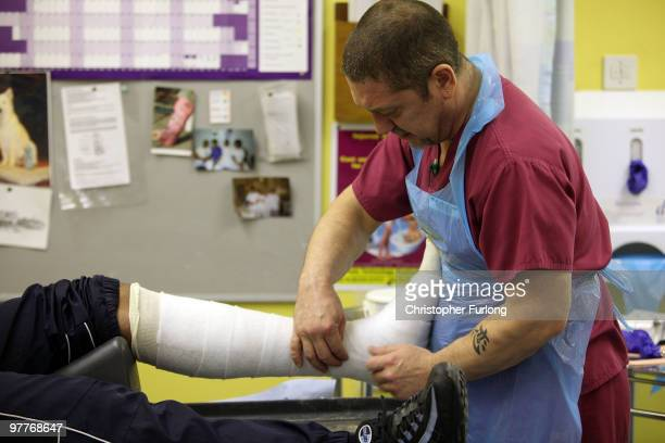 An orthopaedic practitioner casts a broken ankle in the accident and emergency dept of Selly Oak Hospital on March 16 2010 in Birmingham England As...