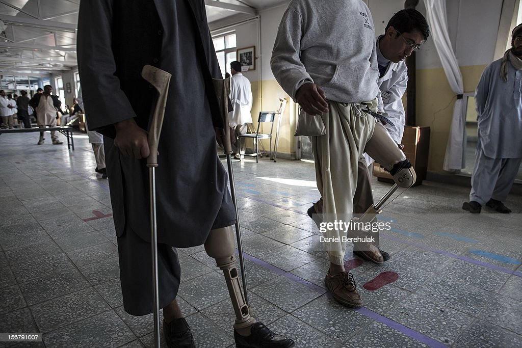 An orthopedic specialist checks the mobility of new prosthetic limb being fitted on to a patient at the International Committee of the Red Cross (ICRC), orthopedic centre on November 20, 2012 in Kabul, Afghanistan. The ICRC rehabilitation centre works to educate and rehabilitate land-mine victims, and those with limb related deformities, back into society and employment offering micro-credit financing, home schooling and vocational training to patients. The clinic itself is unique in that all of the workers are handicapped. The ICRC centre in Kabul has registered over 57,000 patients and 114,000 countrywide in all of their centres since its inception 25 years ago.