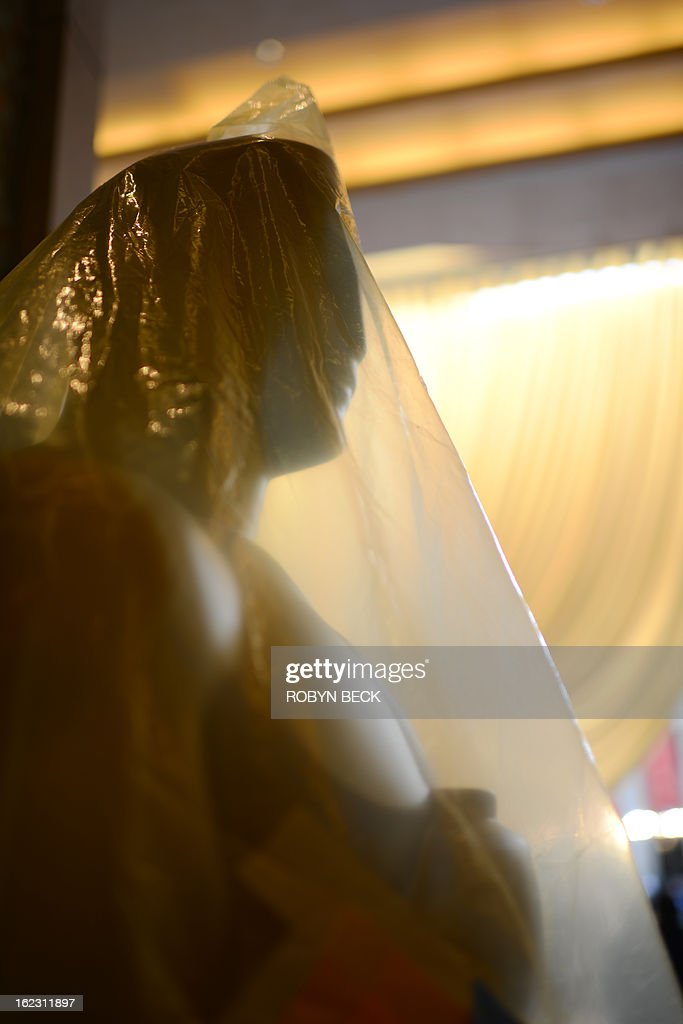 An Oscar statue is wrapped in plastic during preparations for the 85th Academy Awards show, February 21, 2013, at the Dolby Theatre in Hollywood California. The Oscars will be handed out at the Academy Awards awards show in Hollywood on February 24.