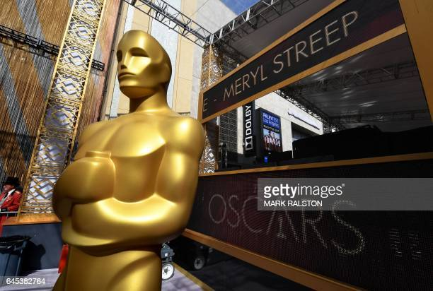 An Oscars statue on the red carpet arrivals area as a digital screen displays the name of Meryl Streep ahead of the 89th annual Oscars at the Dolby...