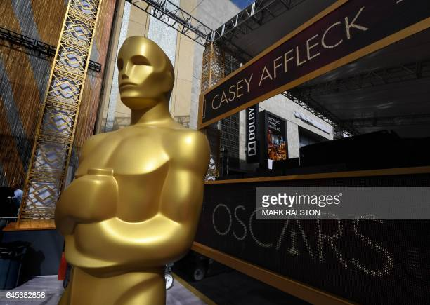 An Oscars statue on the red carpet arrivals area as a digital screen displays the name of actor Casey Affleck ahead of the 89th annual Oscars at the...