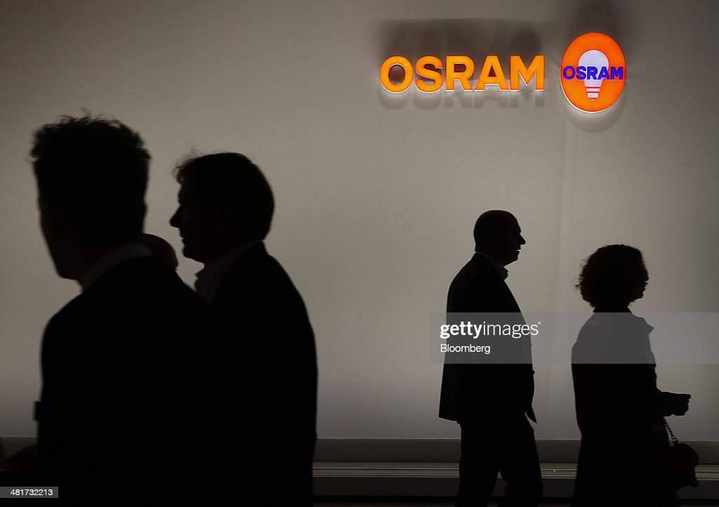 An Osram logo sits on display in the Osram Licht AG booth at the Light and Building Architecture and Technology Fair, in Frankfurt, Germany, on Monday, March 31, 2014. The Light and Building Architecture and Technology Fair takes place from March 30 to April 4 2014. Photographer: Ralph Orlowski/Bloomberg via Getty Images