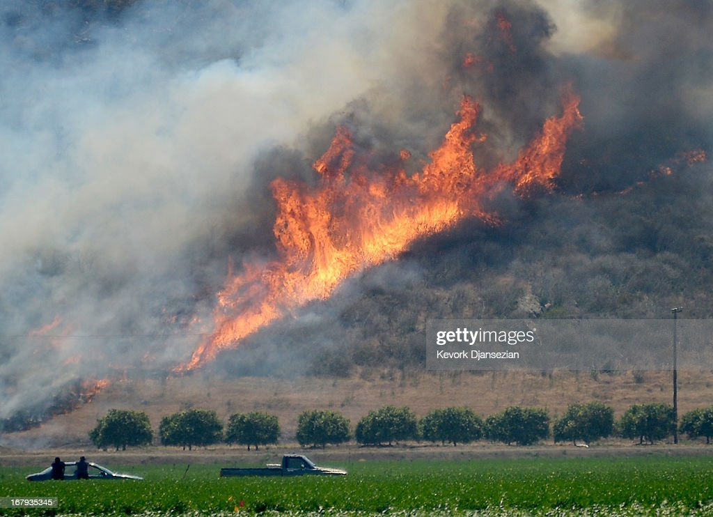 An out of control wildfire burns in the hillside near an agricultural farm on May 2, 2013 in Camarillo, California. Hundreds of firefighters are battling wind and dry conditions as over 6000 acres have already been burned northwest of Los Angeles.