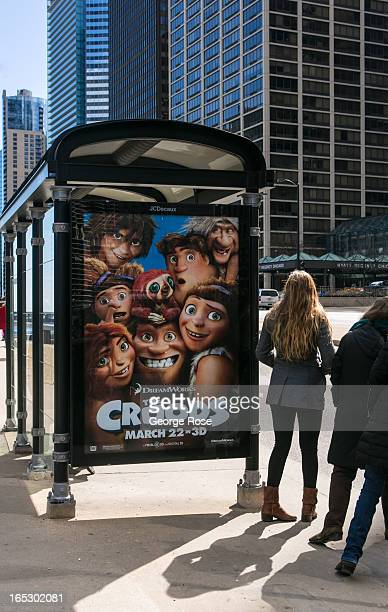 An outdoor billboard promoting the movie 'The Croods' is shown at a Michigan Avenue bus stop on March 26 2013 in Chicago Illinois Visitors to the...