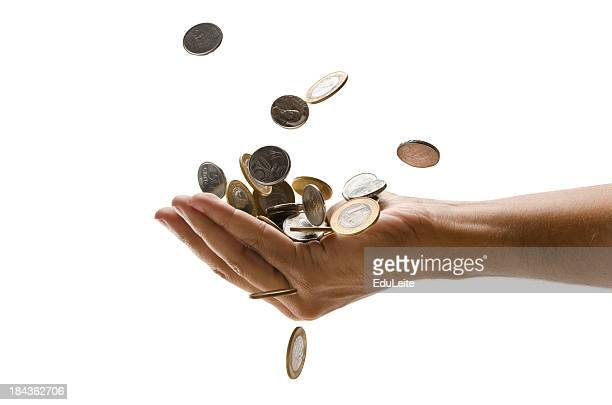 An outreached hand catching a pile of falling Euro coins