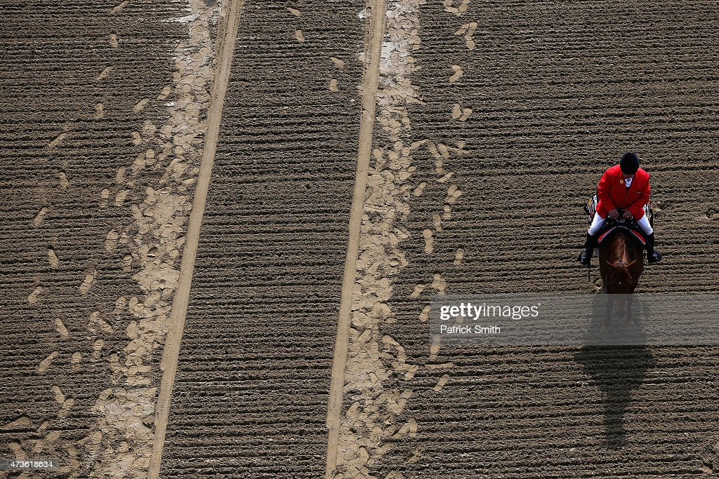 An outrider sits on a horse for a race prior to the 140th running of the Preakness Stakes at Pimlico Race Course on May 16 2015 in Baltimore Maryland